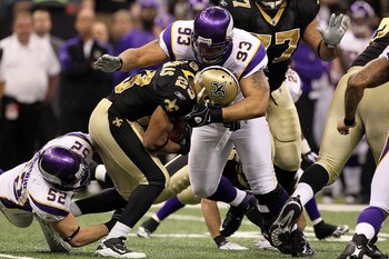 NEW ORLEANS - JANUARY 24:  Kevin Williams #93 of the Minnesota Vikings tackles Pierre Thomas #23 of the New Orleans Saints during the NFC Championship Game at the Louisiana Superdome on January 24, 2010 in New Orleans, Louisiana. The Saints won 31-28 in o