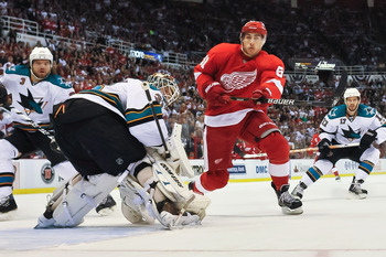 DETROIT - MAY 4: Valtteri Filppula #51 of the Detroit Red Wings skates past goaltender Antti Niemi #31 of the San Jose Sharks in Game Three of the Western Conference Semifinals during the 2011 NHL Stanley Cup Playoffs on May 4, 2011 at Joe Louis Arena in