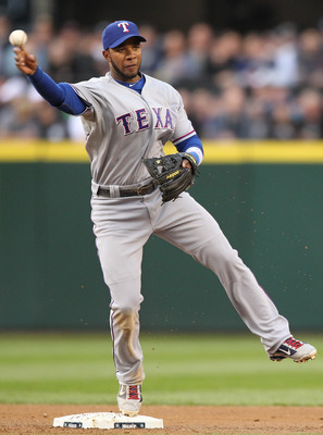 SEATTLE - MAY 04:  Elvis Andrus #1 of the Texas Rangers turns a double play against the Seattle Mariners at Safeco Field on May 4, 2011 in Seattle, Washington. (Photo by Otto Greule Jr/Getty Images)