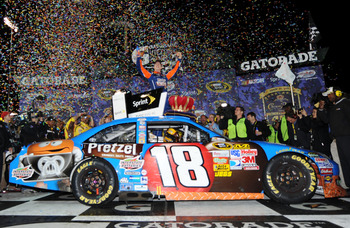 RICHMOND, VA - APRIL 30:  Kyle Busch, driver of the #18 M&M's Pretzel Toyota, celebrates in victory lane after winning the NASCAR Sprint Cup Series Crown Royal Presents The Matthew & Daniel Hansen 400 at Richmond International Raceway on April 30, 2011 in