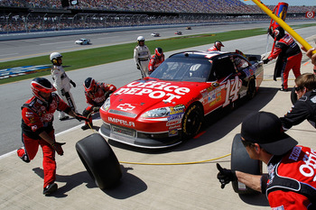 TALLADEGA, AL - APRIL 17:  Tony Stewart, driver of the #14 Office Depot/Mobil 1 Chevrolet, pits during the NASCAR Sprint Cup Series Aaron's 499 at Talladega Superspeedway on April 17, 2011 in Talladega, Alabama.  (Photo by Todd Warshaw/Getty Images for NA