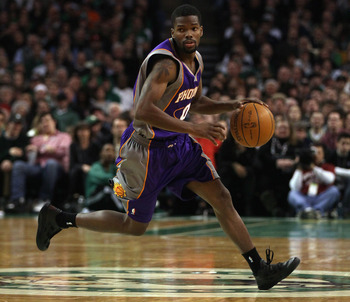 BOSTON, MA - MARCH 02:  Aaron Brooks #0 of the Phoenix Suns heads up the court in the second half against the Boston Celtics on March 2, 2011 at the TD Garden in Boston, Massachusetts.  The Celtics defeated the Suns 115-103. NOTE TO USER: User expressly a