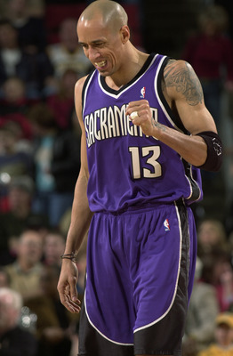 SEATTLE - JANUARY 31:  Doug Christie #13 of the Sacramento Kings during the game against the Seattle Sonics on January 31, 2004 at Key Arena in Seattle, Washington.  The Kings won 110-103.  NOTE TO USER: User expressly acknowledges and agrees that, by dow