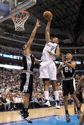 DALLAS - APRIL 27:  Forward Caron Butler #4 of the Dallas Mavericks drives the hoop against Tim Duncan #21 of the San Antonio Spurs in Game Five of the Western Conference Quarterfinals during the 2010 NBA Playoffs at American Airlines Center on April 27,