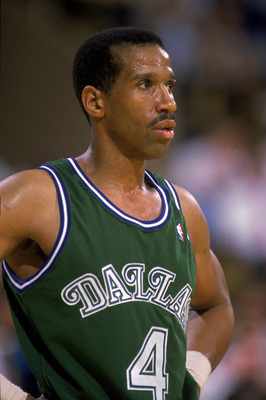 LOS ANGELES - 1989:  Adrian Dantley #4 of the Dallas Mavericks stands on the court during the NBA game against the Los Angeles Lakers at the Great Western Forum in Los Angeles, California in 1989.  (Photo by Stephen Dunn/Getty Images)