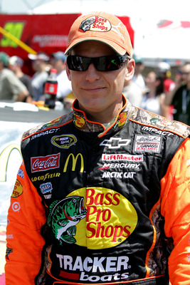 LOUDON, NH - JULY 17: Jamie McMurray, driver of the #1 Bass Pro Shops/Tracker Chevrolet, waits on the grid prior to the NASCAR Sprint Cup Series LENOX Industrial Tools 301 at New Hampshire Motor Speedway on July 17, 2011 in Loudon, New Hampshire.  (Photo