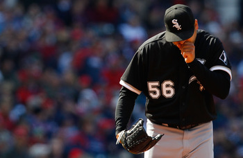 CLEVELAND - APRIL 01:  Mark Buehrle #56 of the Chicago White Sox warms his hands during the Opening Day game against the Cleveland Indians on April 1, 2011 at Progressive Field in Cleveland, Ohio. The high temperature in Cleveland only reached 44 degrees.