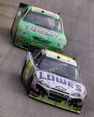 DOVER, DE - SEPTEMBER 26:  Jimmie Johnson drives the #48 Lowe's Chevrolet ahead of Kyle Busch, driver of the #18 Interstate Batteries Toyota, during the NASCAR Sprint Cup Series AAA 400 at Dover International Speedway on September 26, 2010 in Dover, Delaw