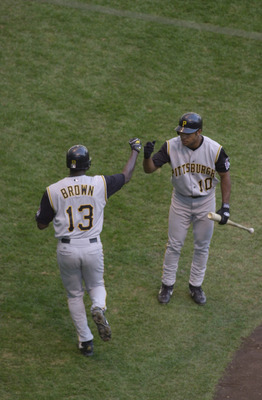 MILWAUKEE-APRIL 17: Abraham Nunez #10 of the Pittsburgh Pirates greets teammate Adrian Brown #13 during the game against  the Milwaukee Brewers at Miller Park in Milwaukee, Wisconsin on April 17,2002. The Pirates won 3-2.  Mandatory Credit: Jonathan Danie
