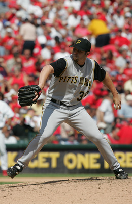 ST. LOUIS - AUGUST 22:  Pitcher John Grabow #39 of the Pittsburgh Pirates delivers against the St. Louis Cardinals during the game at Busch Stadium on August 22, 2004 in St. Louis, Missouri. The Cardinals defeated the Pirates 11-4.  (Photo by Dilip Vishwa