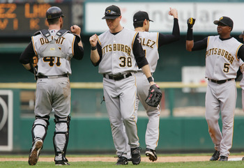ST. LOUIS - SEPTEMBER 14:  Jason Bay #38, Ryan Doumit #41, Tike Redman #5 and Mike Gonzalez #51 of the Pittsburgh Pirates high five each other as they celebrate against the St. Louis Cardinals during the MLB game on September 14, 2005 at Busch Stadium in