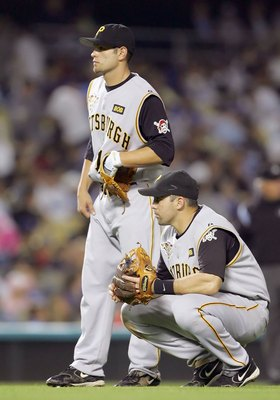 LOS ANGELES - SEPTEMBER 21:   (L-R) Freddy Sanchez #12 and Jack Wilson #2 of the Pittsburgh Pirates wait in the infield durng a pitching change against the Los Angeles Dodgers on September 21, 2006 at Dodger Stadium in Los Angeles, California.  (Photo by