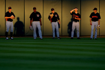 PHOENIX - OCTOBER 16:  (L-R) Pittsburgh Pirates prospects; Tony Watson #13, Donnie Veal #56, Danny Moskos #41, San Francisco Giants prospects; Steve Edlefsen #60 and Joe Martinez #49 all playing for the Scottsdale Scorpions warm up in the outfield before