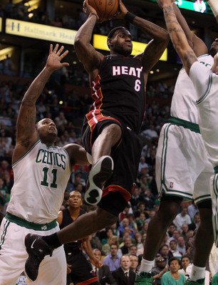 BOSTON, MA - MAY 09:  LeBron James #6 of the Miami Heat tries to pass the ball as Glen Davis #11 and Delonte West #13 of the Boston Celtics defend in Game Four of the Eastern Conference Semifinals in the 2011 NBA Playoffs on May 9, 2011 at the TD Garden i