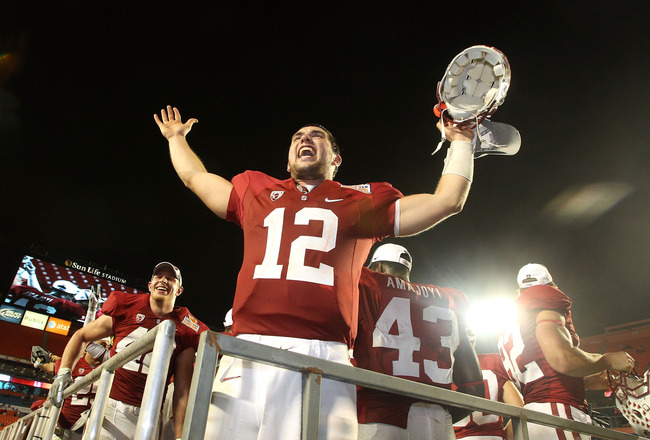 MIAMI, FL - JANUARY 03: Orange bowl MVP Andrew Luck of the Stanford Cardinal celebrates after Stanford won 40-12 against the Virginia Tech Hokies during the 2011 Discover Orange Bowl at Sun Life Stadium on January 3, 2011 in Miami, Florida. (Photo by Stre