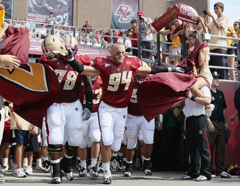 CHESTNUT HILL, MA - SEPTEMBER 25:  Mark Herzlich #94 and Thomas Claiborne #78 of the Boston College Eagles lead the team out on the field before the game against the Virginia Tech Hokies on September 25, 2010 at Alumni Stadium in Chestnut Hill, Massachuse