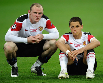 LONDON, ENGLAND - MAY 28: Wayne Rooney of Manchester United (L) and Javier Hernandez show their dissapointment after defeat in the UEFA Champions League final between FC Barcelona and Manchester United FC at Wembley Stadium on May 28, 2011 in London, Engl
