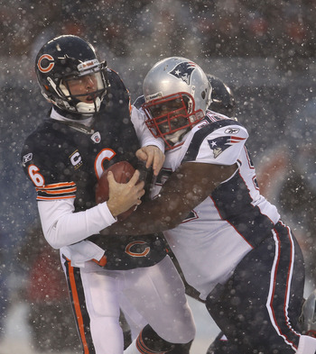 CHICAGO, IL - DECEMBER 12: Jay Cutler #6 of the Chicago Bears is sacked by Gerard Warren #92 of the New England Patriots at Soldier Field on December 12, 2010 in Chicago, Illinois.  The Patriots defeated the Bears 36-7. (Photo by Jonathan Daniel/Getty Ima