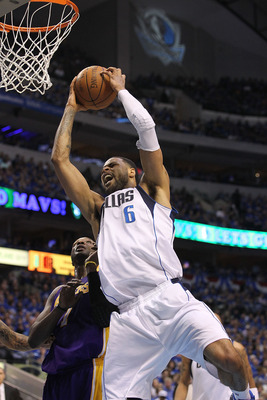 DALLAS, TX - MAY 06:  Center Tyson Chandler #6 of the Dallas Mavericks gets the slam dunk against Lamar Odom #7 of the Los Angeles Lakers in Game Three of the Western Conference Semifinals during the 2011 NBA Playoffs on May 6, 2011 at American Airlines C