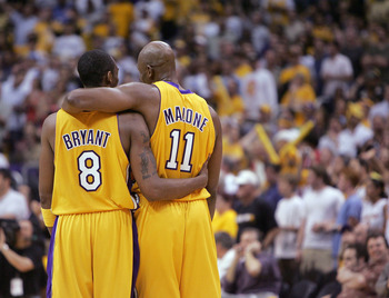LOS ANGELES - MAY 31:  Kobe Bryant #8 and Karl Malone #11 of the Los Angeles Lakers walk downcourt in Game six of the Western Conference Finals against the Minnesota Timberwolves during the 2004 NBA Playoffs on May 31, 2004 at Staples Center in Los Angele