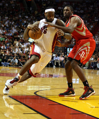 MIAMI, FL - MARCH 27:  Forward LeBron James #6 of the Miami Heat drives against Center Chuck Hayes #44 the Houston Rockets  at American Airlines Arena on March 27, 2011 in Miami, Florida. Miami defeated the Rockets 125-119. NOTE TO USER: User expressly ac