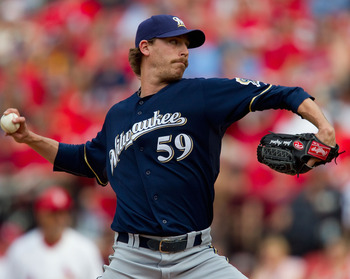 ST. LOUIS, MO - MAY 7:  Reliever John Axford #59 of the Milwaukee Brewers pitches against the St. Louis Cardinals at Busch Stadium on May 7, 2011 in St. Louis, Missouri.  (Photo by Dilip Vishwanat/Getty Images)
