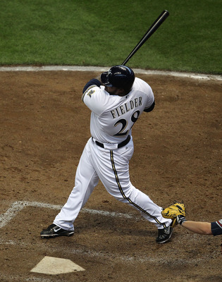 MILWAUKEE, WI - APRIL 04: Prince Fielder #28 of the Milwaukee Brewers hits the ball against the Atlanta Braves during the home opener at Miller Park on April 4, 2011 in Milwaukee, Wisconsin. The Braves defeated the Brewers 2-1. (Photo by Jonathan Daniel/G
