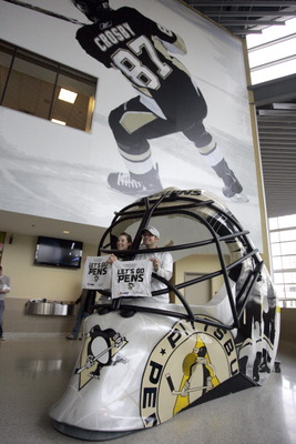 PITTSBURGH, PA - APRIL 23:  Pittsburgh Penguins fans pose for a photo in a giant goalie mask before the start of the game between the Pittsburgh Penguins and the Tampa Bay Lightning in Game Five of the Eastern Conference Quarterfinals during the 2011 NHL