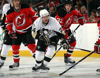 NEWARK, NJ - MARCH 04:  Matt Cooke #24 of the Pittsburgh Penguins skates against the New Jersey Devils at the Prudential Center on March 4, 2011 in Newark, New Jersey. The Devils defeated the Penguins 2-1 in overtime.  (Photo by Bruce Bennett/Getty Images