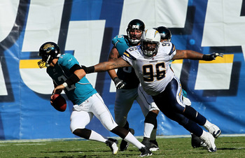 SAN DIEGO - SEPTEMBER 19: Defensive lineman Travis Johnson #96 of the San Diego Chargers pursues quarterback Luke McCowen #12 of of the Jacksonville Jaguars at Qualcomm Stadium on September 19, 2010 in San Diego, California. The Chargers won 38-13.  (Phot