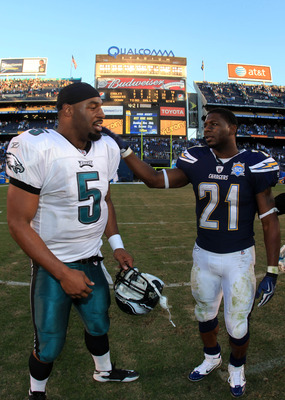 SAN DIEGO, CA - NOVEMBER 15:  Runningback LaDainian Tomlinson #21 of the San Diego Chargers meets Quarterback Donavan McNabb #5 of the Philadelphia Eagles on the field at the end of the NFL football game on November 15, 2009 at Qualcomm Stadium in San Die