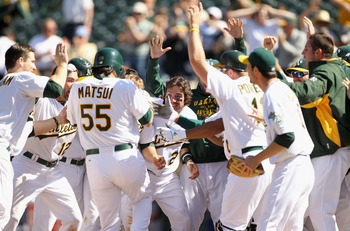 OAKLAND, CA - MAY 02:  Hideki Matsui #55 of the Oakland Athletics is congratulated by teammates after he hit a walk off home run to win the game in the tenth inning against the Texas Rangers at Oakland-Alameda County Coliseum on May 2, 2011 in Oakland, Ca