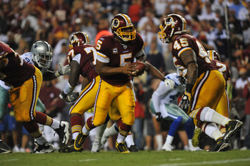 LANDOVER - SEPTEMBER 12:  Donovan McNabb #5 of the Washington Redskins hands off during the NFL season opener against the Dallas Cowboys at FedExField on September 12, 2010 in Landover, Maryland. The Redskins defeated the Cowboys 13-7. (Photo by Larry Fre