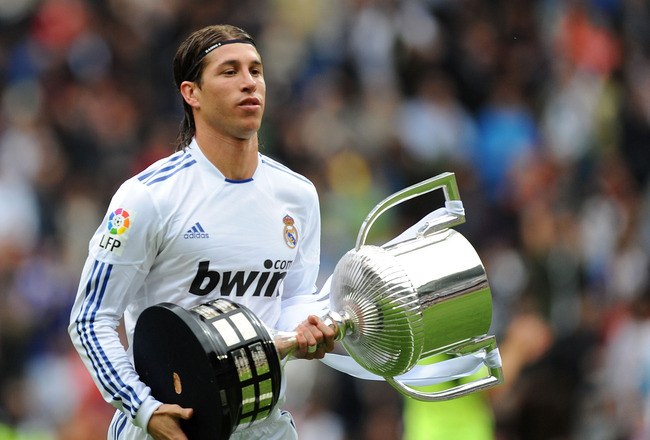 MADRID, SPAIN - APRIL 30: Sergio Ramos of Real Madrid walks away with the recently won Copa del Rey trophy before the La Liga match between Real Madrid and Real Zaragona at Estadio Santiago Bernabeu on April 30, 2011 in Madrid, Spain.  (Photo by Denis Doy