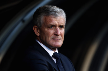 LONDON, ENGLAND - APRIL 27:  Fulham Manager, Mark Hughes looks on during the Barclays Premier League match between Fulham and Bolton Wanderers at Craven Cottage on April 27, 2011 in London, England.  (Photo by Dean Mouhtaropoulos/Getty Images)