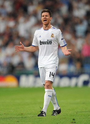 MADRID, SPAIN - APRIL 27:  Xabi Alonso of Real Madrid reacts during the UEFA Champions League Semi Final first leg match between Real Madrid and Barcelona at the Estadio Santiago Bernabeu on April 27, 2011 in Madrid, Spain.  (Photo by Jasper Juinen/Getty