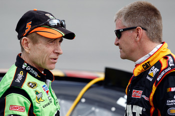RICHMOND, VA - APRIL 29:  Jeff Burton, driver of the #31 Caterpillar Chevrolet, speaks with Mark Martin, driver of the #5 GoDaddy.com Chevrolet, during qualifying for the NASCAR Sprint Cup Series Crown Royal Presents The Matthew & Daniel Hansen 400 at Ric