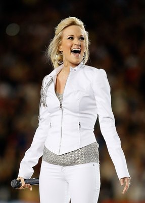 MIAMI GARDENS, FL - FEBRUARY 07:  Singer Carrie Underwood performs during the pregame show prior to Super Bowl XLIV between the Indianapolis Colts and the New Orleans Saints on February 7, 2010 at Sun Life Stadium in Miami Gardens, Florida.  (Photo by And