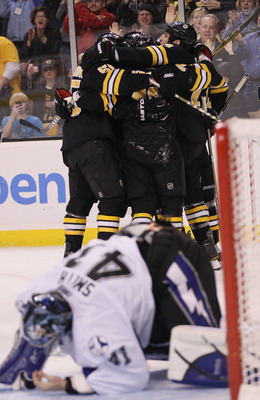 BOSTON, MA - MARCH 03:  Milan Lucic #17 of the Boston Bruins is congratulated by teammates after he scored the game winning goal as Mike Smith #41 of the Tampa Bay Lightning gets up off the ice on March 3, 2011 at the TD Garden in Boston, Massachusetts. T