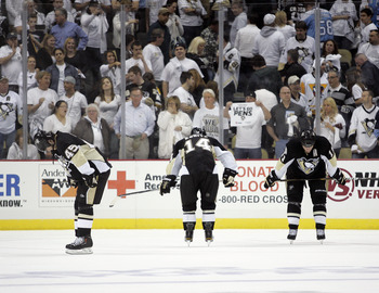 PITTSBURGH, PA - APRIL 27:  Arron Asham #45, Chris Kunitz #14 and Jordan Staal #11 of the Pittsburgh Penguins react after losing to the Tampa Bay Lightning in Game Seven of the Eastern Conference Quarterfinals during the 2011 NHL Stanley Cup Playoffs at C