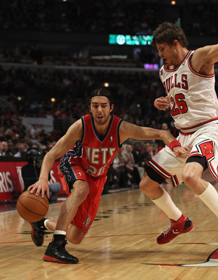 CHICAGO, IL - APRIL 13: Sasha Vujacic #20 of the New Jersey Nets moves against Kyle Korver #26 of the Chicago Bulls at the United Center on April 13, 2011 in Chicago, Illinois. The Bulls defeated the Nets 97-92. NOTE TO USER: User expressly acknowledges a