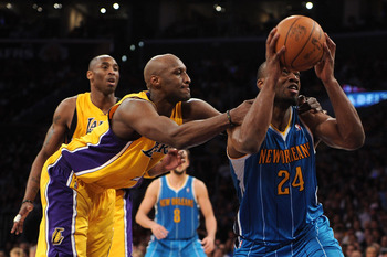 LOS ANGELES, CA - APRIL 26:  Carl Landry #24 of the New Orleans Hornets is grabbed from behind by Lamar Odom #7 of the Los Angeles Lakers in the fourth quarter in Game Five of the Western Conference Quarterfinals in the 2011 NBA Playoffs on April 26, 2011