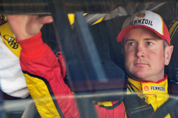RICHMOND, VA - APRIL 29:  Kurt Busch, driver of the #22 Shell/Pennzoil Dodge, sits in his car during practice for the NASCAR Sprint Cup Series Crown Royal Presents The Matthew & Daniel Hansen 400 at Richmond International Raceway on April 29, 2011 in Rich