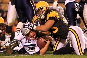 PITTSBURGH - NOVEMBER 14:  Tom Brady #12 of the New England Patriots scores a touchdown under pressure from Troy Polamalu #43 of the Pittsburgh Steelers on November 14, 2010 at Heinz Field in Pittsburgh, Pennsylvania.  (Photo by Chris McGrath/Getty Images