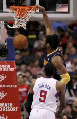 LOS ANGELES, CA - MARCH 5:  Nene #31 of the Denver Nuggets dunks over DAndre Jordan #9 of the Los Angeles Clippers at Staples Center on March 5, 2011 in Los Angeles, California.  NOTE TO USER: User expressly acknowledges and agrees that, by downloading an