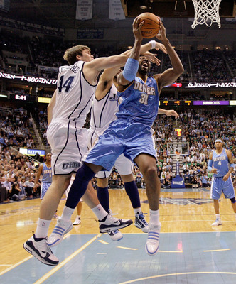 SALT LAKE CITY - APRIL 23: Nene #31 of the Denver Nuggets shoots the ball while defended by Kyrylo Fesenko #44 of the Utah Jazz during  Game 3 of the Western Conference Quarterfinals of the 2010 NBA Playoffs at EnergySolutions Arena on April 23, 2010 in S