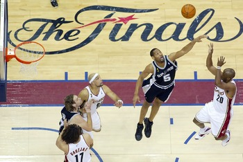 CLEVELAND - JUNE 14: Robert Horry #5 of the San Antonio Spurs tries to block the shot of Eric Snow #20 of the Cleveland Cavaliers in Game Four of the NBA Finals on June 14, 2007 at the Quicken Loans Arena in Cleveland, Ohio. NOTE TO USER: User expressly a