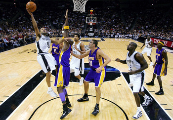 SAN ANTONIO - NOVEMBER 29:  Guard Tony Parker #9 of the San Antonio Spurs drives to the hoop against Lamar Odom #7 of the Los Angeles Lakers on November 29, 2005 at the SBC Center in San Antonio, Texas.  NOTE TO USER: User expressly acknowledges and agree