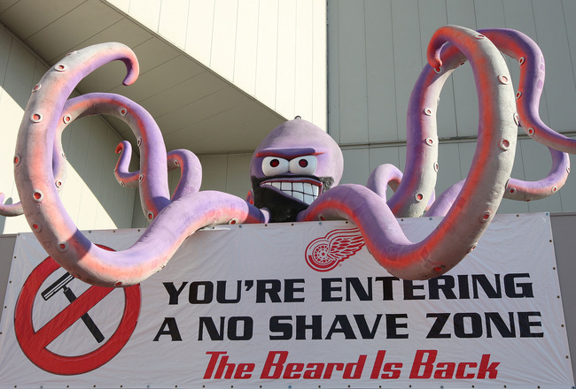 DETROIT - MAY 31:  The octopus mascot of the Detroit Red Wings is seen above a a sign reading 'You're Enteriing a No Shave Zone' before Game Two of the 2009 Stanley Cup Finals at Joe Louis Arena on May 31, 2009 in Detroit, Michigan.  (Photo by Jim McIsaac
