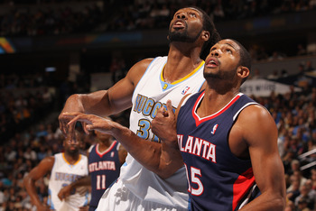 DENVER, CO - FEBRUARY 28:  Nene #31 of the Denver Nuggets battles for position with Al Horford #15 of the Atlanta Hawks during NBA action at the Pepsi Center on February 28, 2011 in Denver, Colorado. The Nuggets deafeated the Hawks 100-90. NOTE TO USER: U